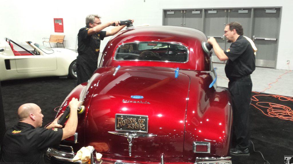 OCDCarCare at SEMA 2013 - Derek Bemiss, Jason Rose, & Kevin Brown final polish a 1940 Oldsmobile in the House of Kolors booth.