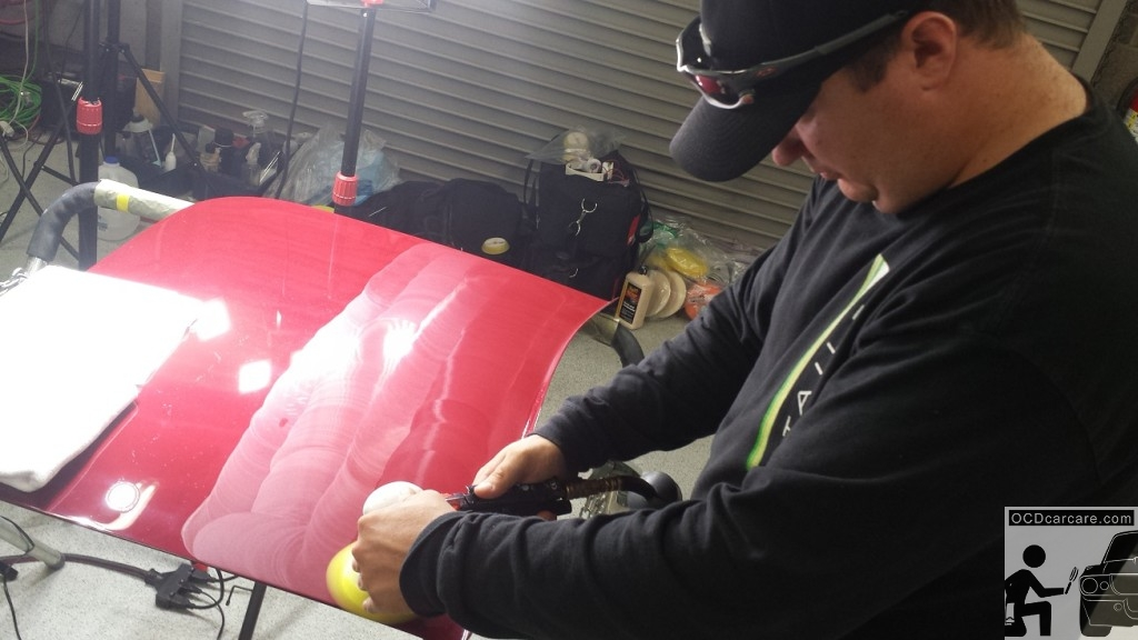 Scott Nichols of Distinct Detail patiently final polishes the delicate tonneau cover of the 1956 Maserati 150S for the 2014 Pebble Beach Concours d' Elegance