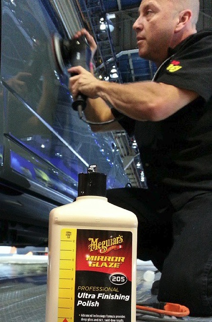 Kevin Brown of www.Buffdaddy.com at 2014 SEMA Polishing with the KBM method and Meguiars M205. Santa Maria, Ca.