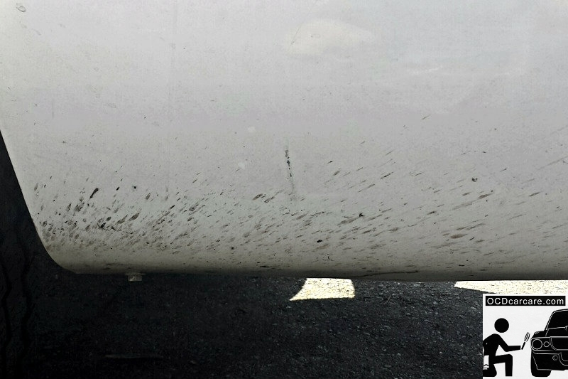 Common Automotive Paint Correction Defects: Road Tar occurs when contaminants from the road are kicked up onto vehicles.
