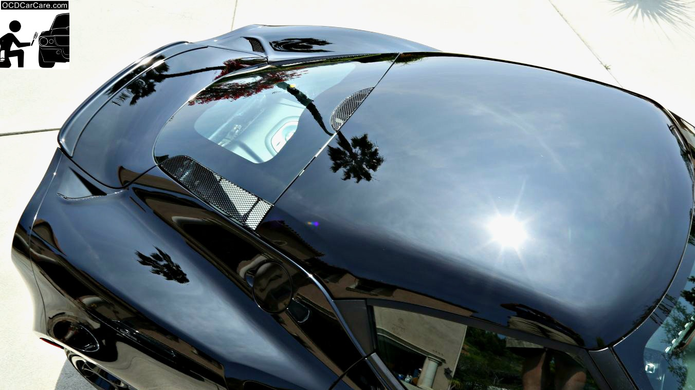 Sun Reflection on this jet black Alfa Romeo 4C displays refined, glossy, clear, and reflective paint with a nano coating by OCDCarCare.