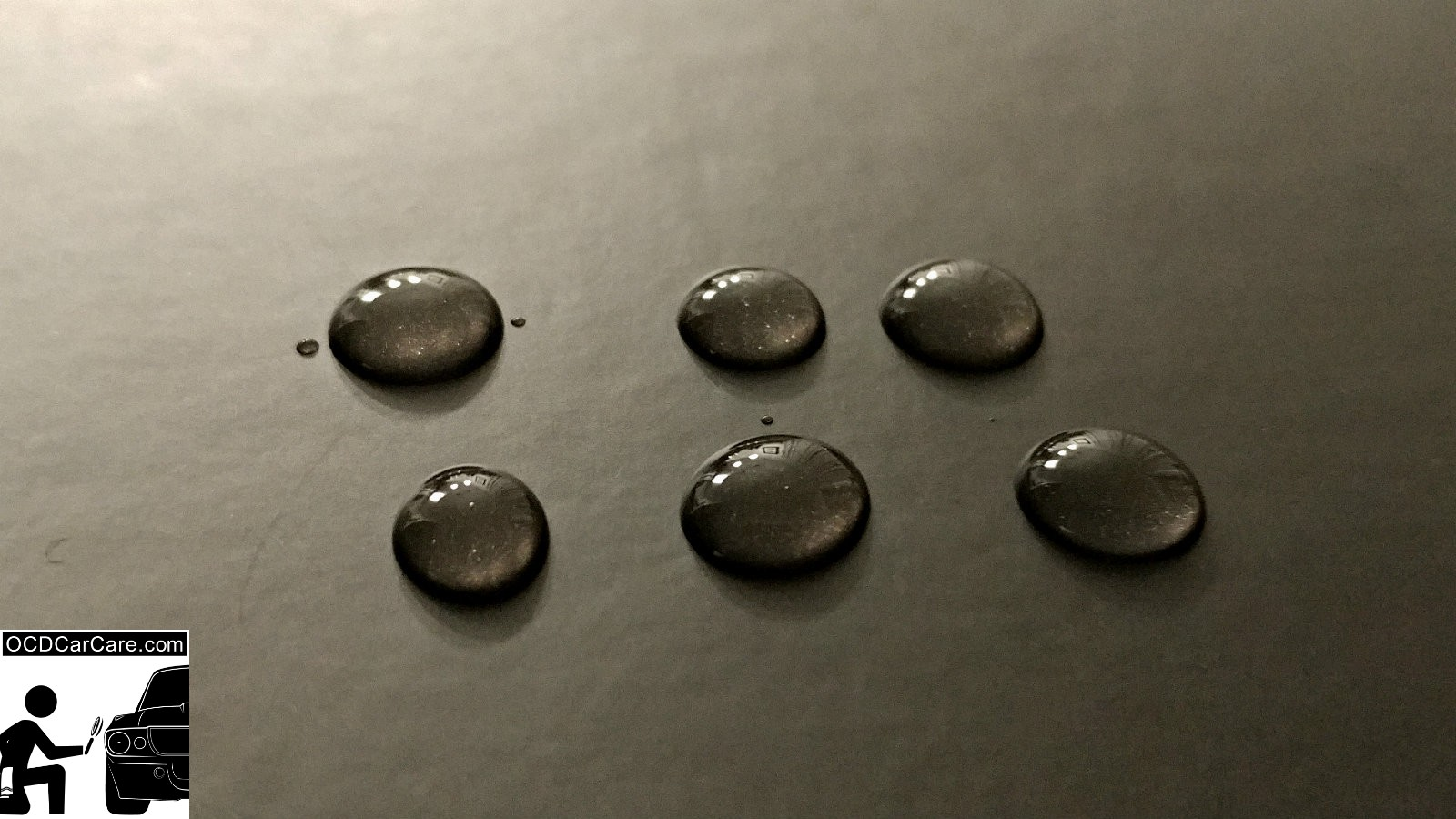 High surface tension from a ceramic paint coating causes the surface to be hydrophobic - detailing training article by Christopher Brown of OCDCarCare Los Angeles.