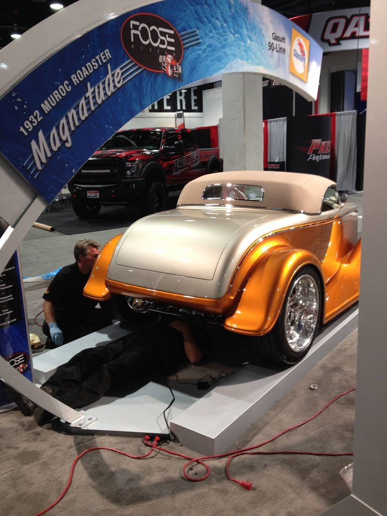 "OCDCarCare at SEMA 2013 - Derek Bemiss & Kevin Brown finish polish Chip Foose's ""Magnatude."""