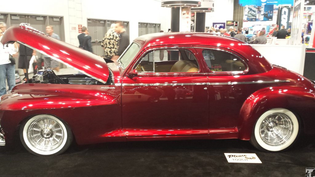 SEMA 2013 - 1940 Olds received full paint correction in the House of Kolors booth.