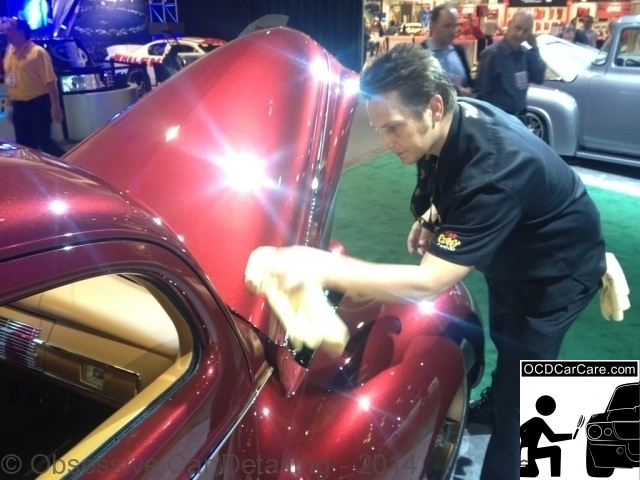 """OCDCarCare SEMA 2013 - Christopher Brown, of OCDCarCare, gently wiping down the 2013 Rdiler Award winner """"Checkerd Past."""""""