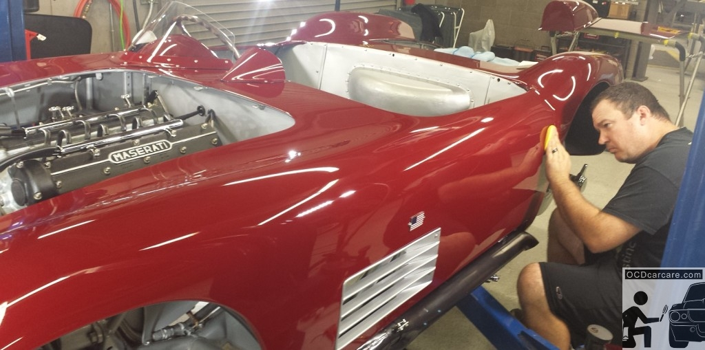 Scott Nichols of Distinct Detail carefully applies the first coat wax on this Maserati 150S.